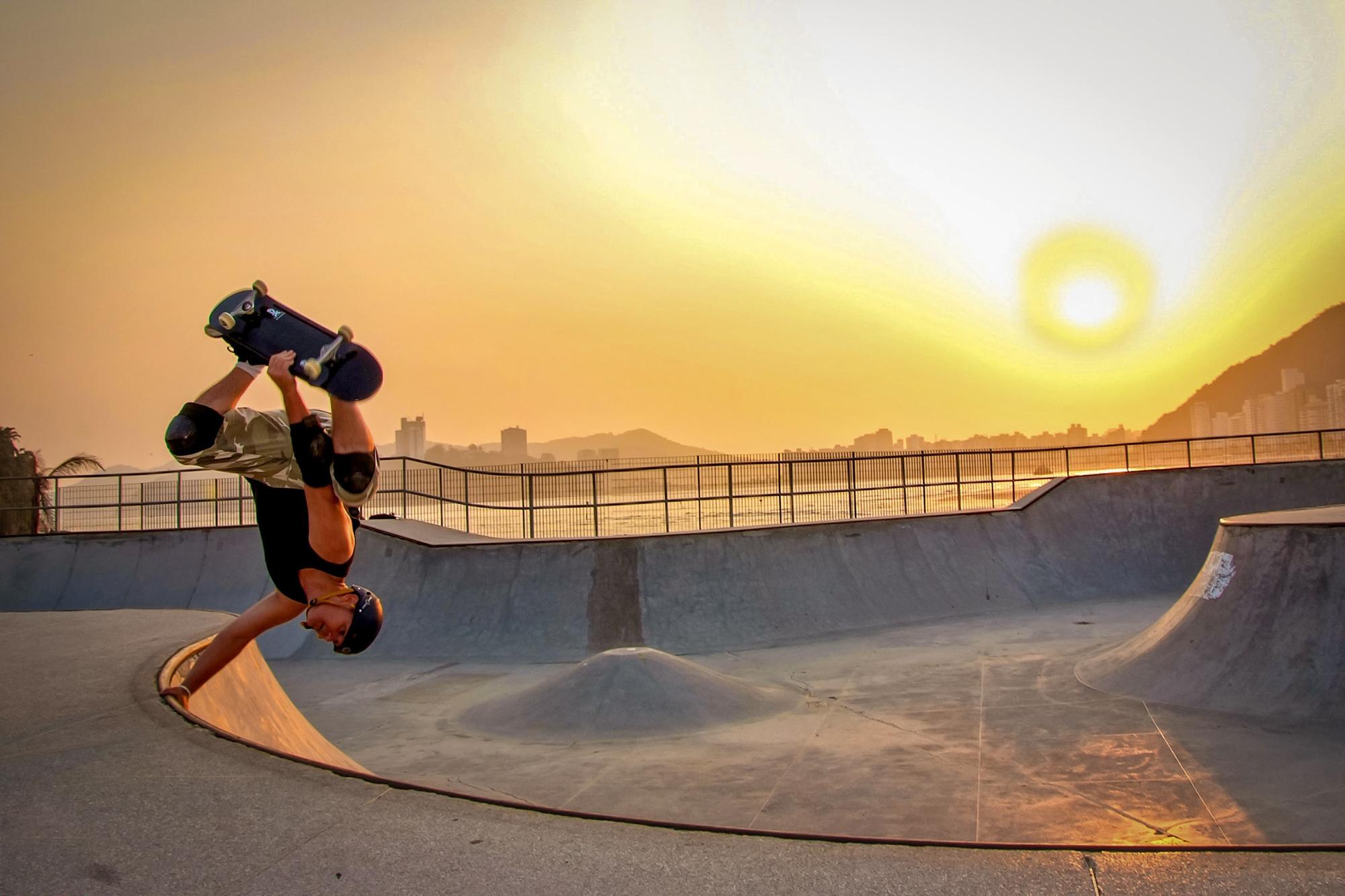 skateboard ramp trick park sunset flip
