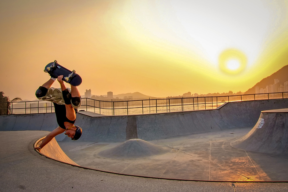 skateboard ramp trick park sunset flip